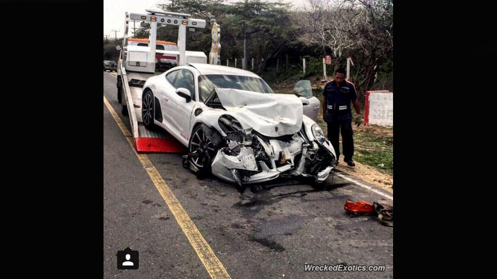 porsche 911 accidente grua