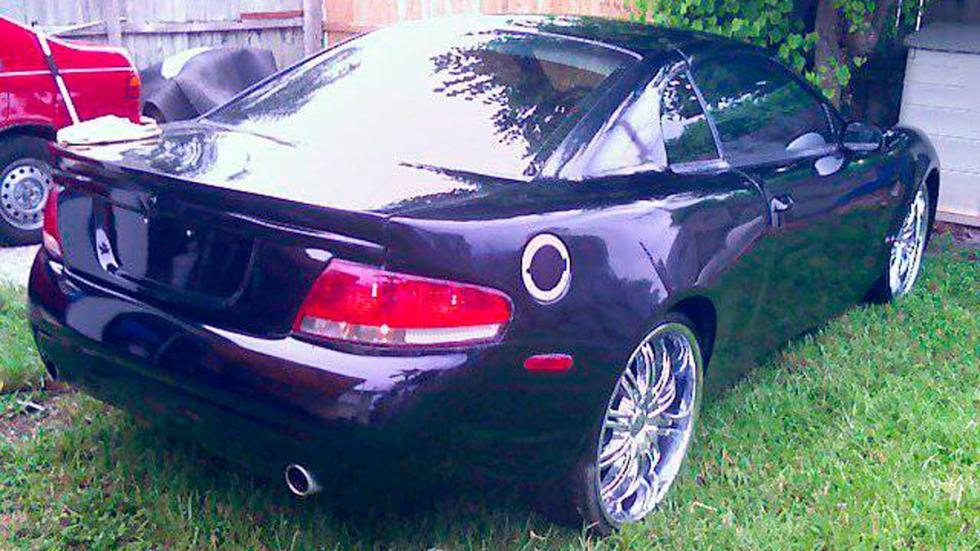 Ford Mustang Aston Martin vanquish trasera